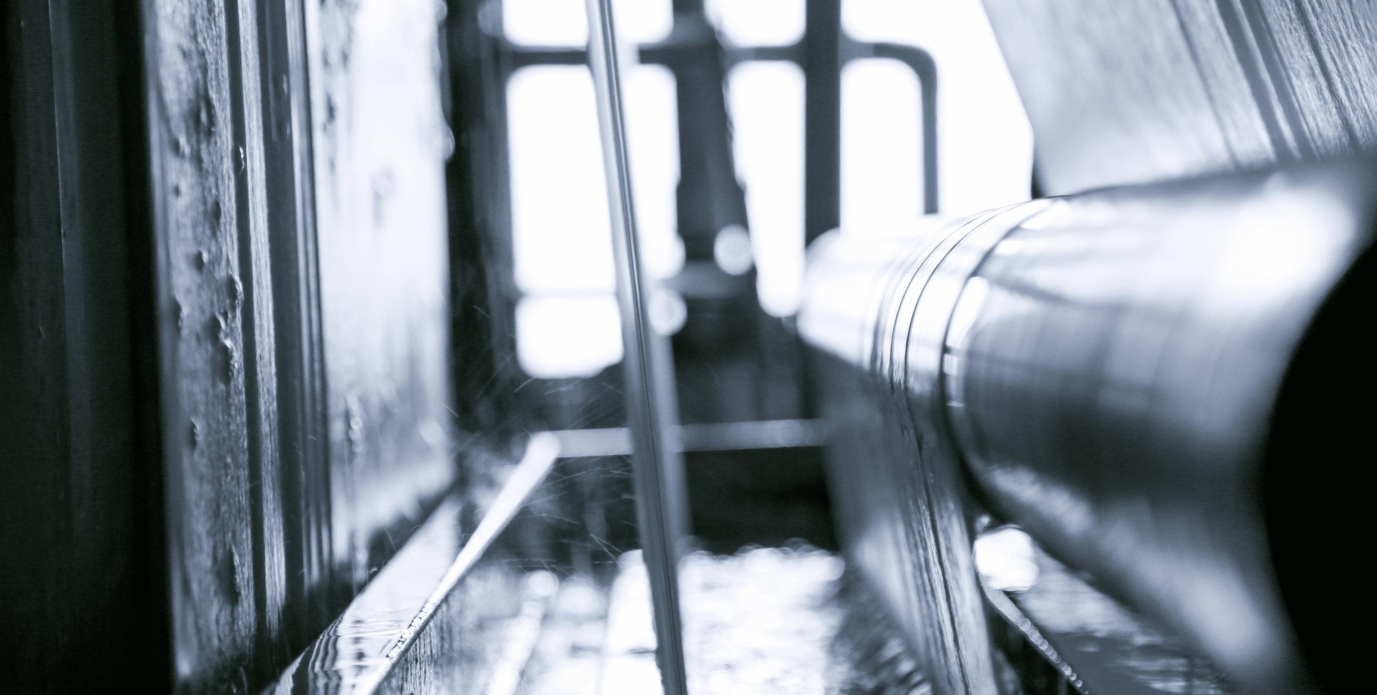 生地の糊や油剤を落とす工程